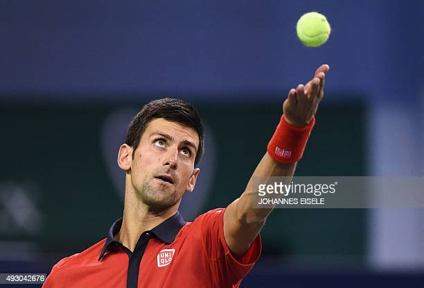 Novak Djokovic of Serbia serves during his men's singles semifinal match against Andy Murray of Britain at the Shanghai Masters tennis tournament in...