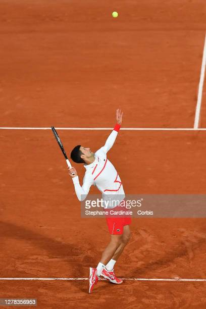 Novak Djokovic of Serbia serves during his Men's Singles third round match against Daniel Elahi Galan of Colombia on day seven of the 2020 French...
