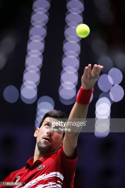 Novak Djokovic of Serbia serves during his quarter final doubles match against Russia on Day Five of the 2019 Davis Cup at La Caja Magica on November...