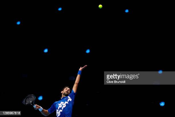 Novak Djokovic of Serbia serves during his singles match against Diego Schwartzman of Argentina on day two of the Nitto ATP World Tour Finals at The...