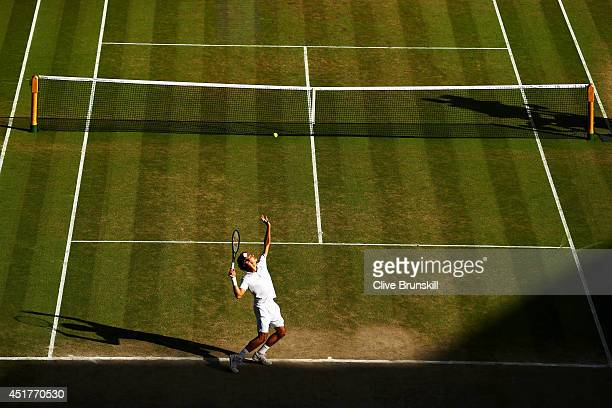 Novak Djokovic of Serbia serves during the Gentlemen's Singles Final match against Roger Federer of Switzerland on day thirteen of the Wimbledon Lawn...