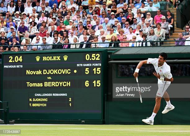 Novak Djokovic of Serbia serves during the Gentlemen's Singles quarterfinal match against Tomas Berdych of Czech Republic on day nine of the...