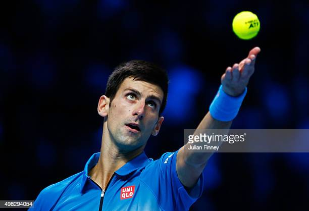 Novak Djokovic of Serbia serves during the men's singles final against Roger Federer of Switzerland on day eight of the Barclays ATP World Tour...