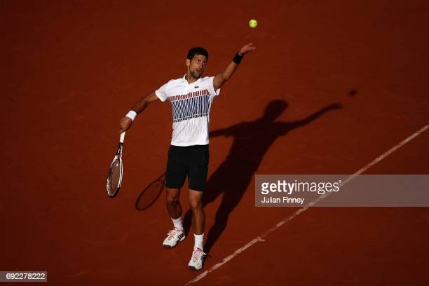 Novak Djokovic of Serbia serves during the mens singles fourth round match against Albert RamosVinolas of Spain on day eight of the 2017 French Open...