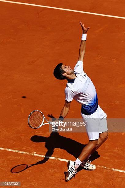 Novak Djokovic of Serbia serves during the men's singles second round match between Novak Djokovic of Somalia and Kei Nishikori of Japan at the...