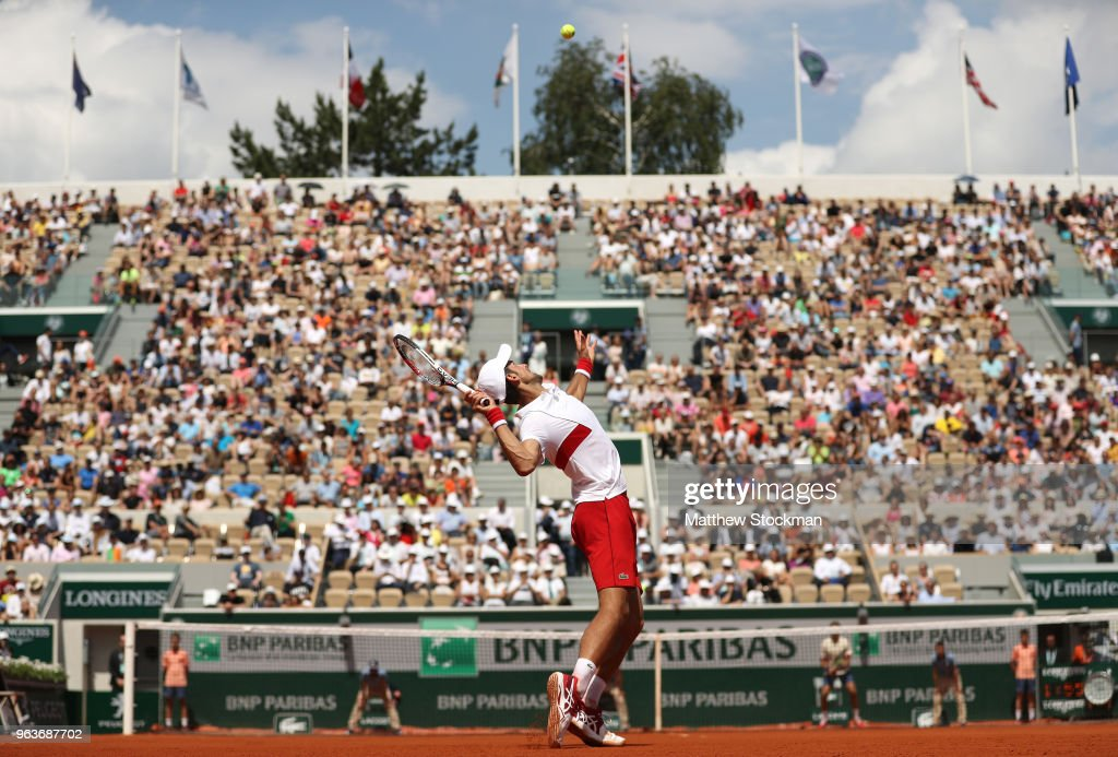 Novak Djokovic of Serbia serves during the mens singles second round match against Jaume Munar of Spain during day four of the 2018 French Open at Roland Garros on May 30, 2018 in Paris, France.