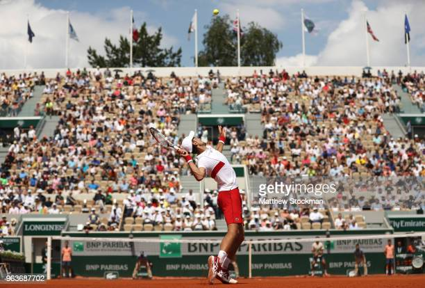 Novak Djokovic of Serbia serves during the mens singles second round match against Jaume Munar of Spain during day four of the 2018 French Open at...