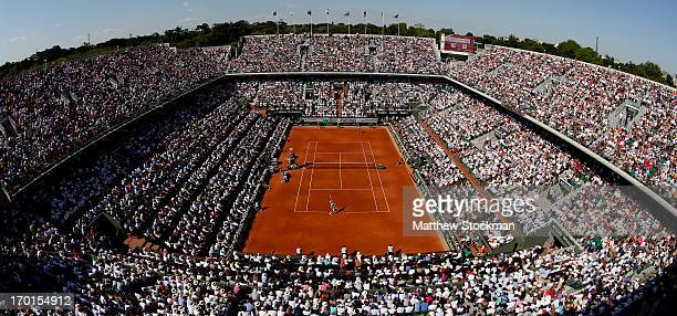 Novak Djokovic of Serbia serves during the men's singles semifinal match against Rafael Nadal of Spain on day thirteen of the French Open at Roland...