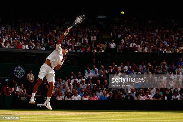 Novak Djokovic of Serbia serves in his Gentlemens Singles Quarter Final match against Marin Cilic of Croatia during day nine of the Wimbledon Lawn...