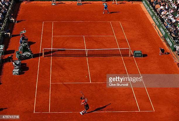 Novak Djokovic of Serbia serves in his Men's quarter final match against Rafael Nadal of Spain on day eleven of the 2015 French Open at Roland Garros...