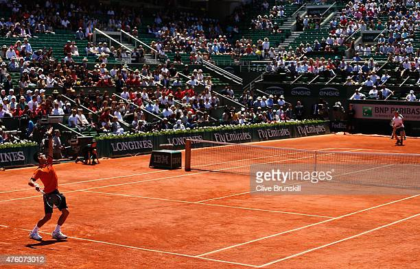 Novak Djokovic of Serbia serves in his Men's Semi Final match against Andy Murray of Great Britain on day fourteen of the 2015 French Open at Roland...