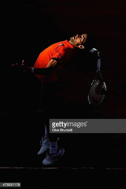 Novak Djokovic of Serbia serves in his Men's Singles match against Richard Gasquet of France on day nine of the 2015 French Open at Roland Garros on...