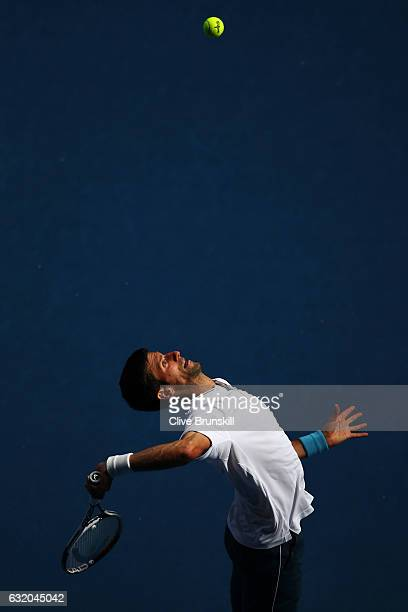 Novak Djokovic of Serbia serves in his second round match against Denis Istomin of Uzbekistan on day four of the 2017 Australian Open at Melbourne...