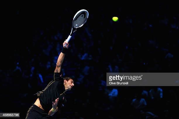 Novak Djokovic of Serbia serves in the round robin singles match against Tomas Berdych of Czech Republic on day six of the Barclays ATP World Tour...
