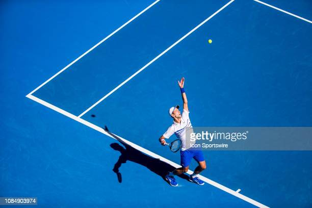 Novak Djokovic of Serbia serves the ball during day 6 of the Australian Open on January 19 2019 at Melbourne Park in Melbourne Australia