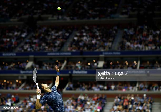 Novak Djokovic of Serbia serves the ball during his men's Singles finals match against Juan Martin del Potro of Argentina on Day Fourteen of the 2018...