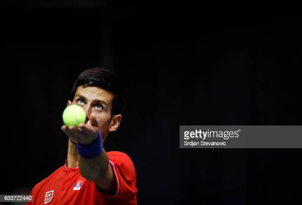Novak Djokovic of Serbia serves the ball to Daniil Medvedev of Russia during the Davis Cup World Group first round single match between Serbia and...
