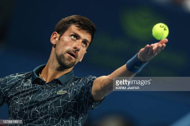Novak Djokovic of Serbia serves the ball to Nikoloz Basilashvili of Georgia during their ATP Qatar Open tennis quarterfinal in Doha on January 3 2019