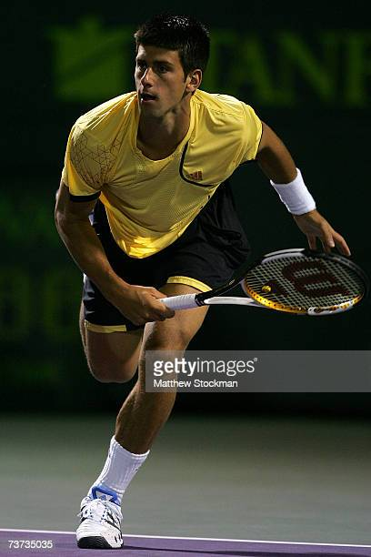 Novak Djokovic of Serbia serves to during his match against Rafael Nadal of Spain during day eight at the 2007 Sony Ericsson Open at the Tennis...