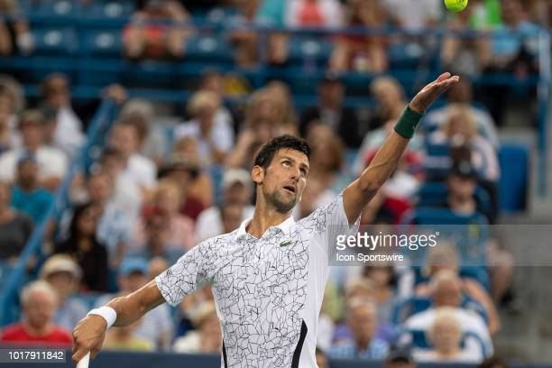 Novak Djokovic of Serbia serves to Grigor Dimitrov of Bulgaria during Day 5 of the Western and Southern Open at the Lindner Family Tennis Center on...