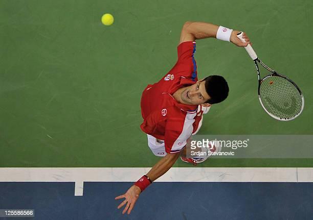 Novak Djokovic of Serbia serves to Juan Martin Del Potro of Argentina during the Davis Cup singles semi final between Serbia and Argentina at...