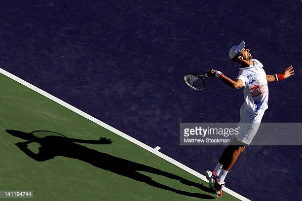 Novak Djokovic of Serbia serves to Kevin Anderson of South Africa during the BNP Paribas Open at the Indian Wells Tennis Garden on March 12 2012 in...