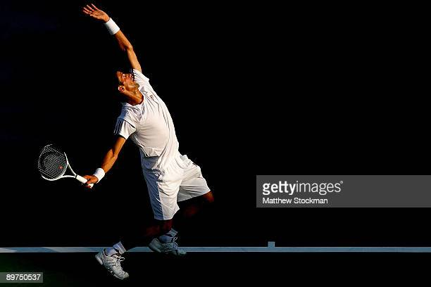 Novak Djokovic of Serbia serves to Peter Polansky of Canada during the Rogers Cup at Uniprix Stadium on August 11 2009 in Montreal Canada