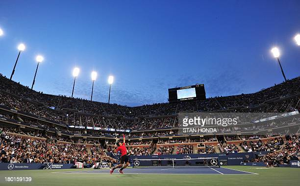 Novak Djokovic of Serbia serves to Rafael Nadal of Spain during their 2013 US Open men's singles final match at the USTA Billie Jean King National...