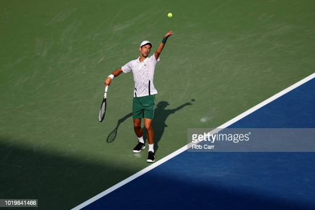 Novak Djokovic of Serbia serves to Roger Federer of Switzerland in the mens final during Day 9 of the Western and Southern Open at the Lindner Family...