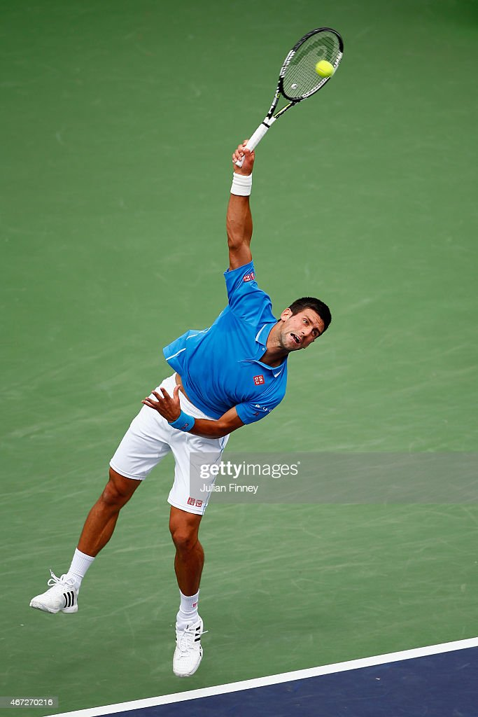 Novak Djokovic of Serbia serves to Roger Federer of Switzerland in the final during day fourteen of the BNP Paribas Open tennis at the Indian Wells Tennis Garden on March 22, 2015 in Indian Wells, California.