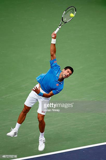 Novak Djokovic of Serbia serves to Roger Federer of Switzerland in the final during day fourteen of the BNP Paribas Open tennis at the Indian Wells...