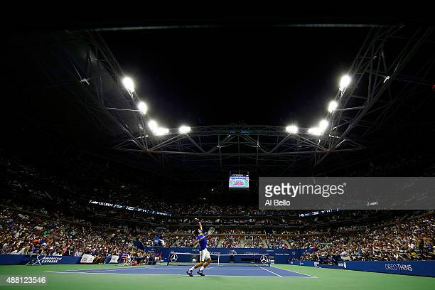 Novak Djokovic of Serbia serves to Roger Federer of Switzerland during their Men's Singles Final match on Day Fourteen of the 2015 US Open at the...