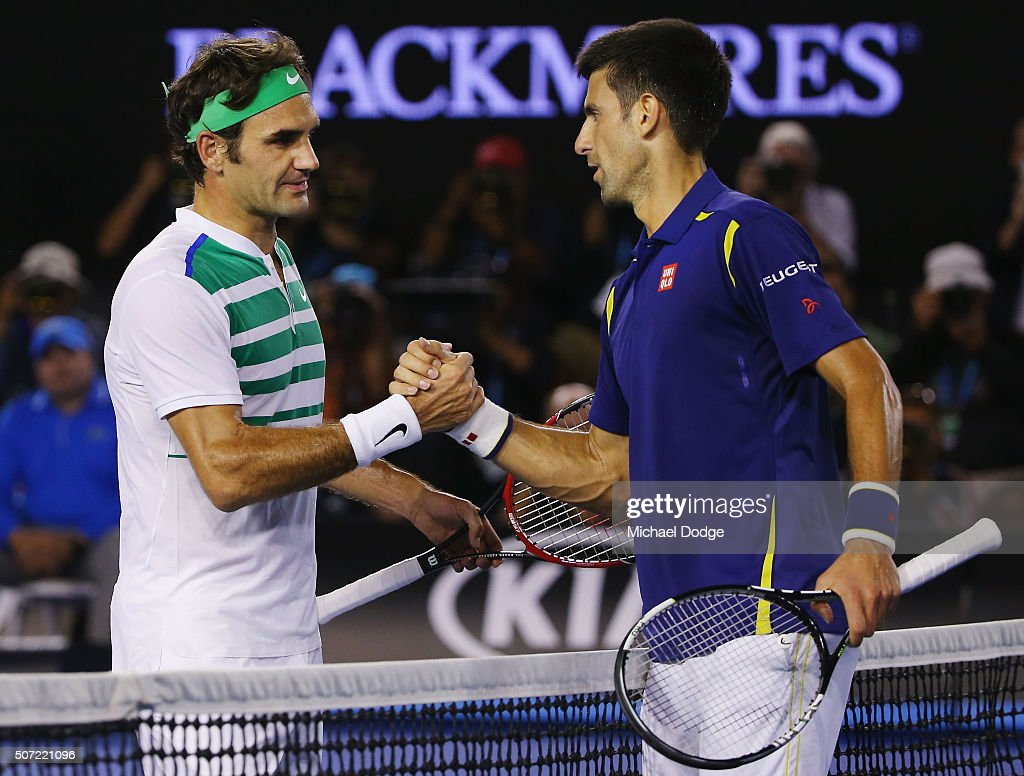 Novak Djokovic of Serbia (R) shakes hands after winning in his semi final match against Roger Federer of Switzerland during day 11 of the 2016 Australian Open at Melbourne Park on January 28, 2016 in Melbourne, Australia.