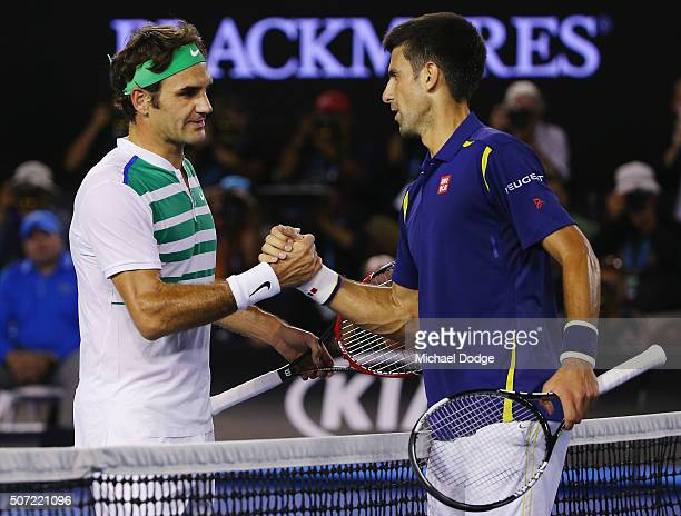 Novak Djokovic of Serbia shakes hands after winning in his semi final match against Roger Federer of Switzerland during day 11 of the 2016 Australian...