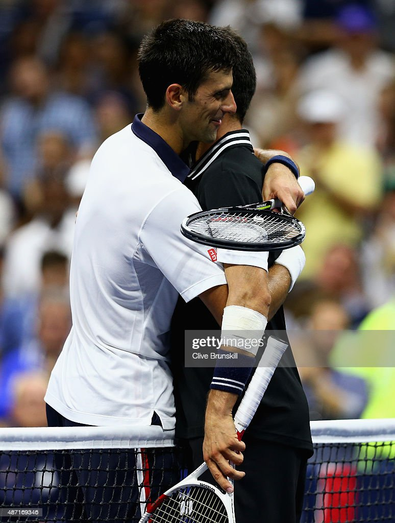 Novak Djokovic of Serbia shakes hands at the net after his four set victory against Roberto Bautista Agut of Spain in their mens singles fourth round match on Day Seven of the 2015 US Open at the USTA Billie Jean King National Tennis Center on September 6, 2015 in the Flushing neighborhood of the Queens borough of New York City.