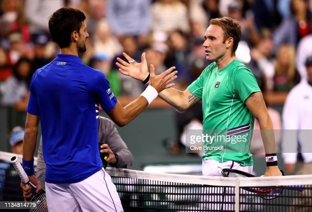Novak Djokovic of Serbia shakes hands at the net after his straight sets victory against Bjorn Fratangelo of the United States during their men's...