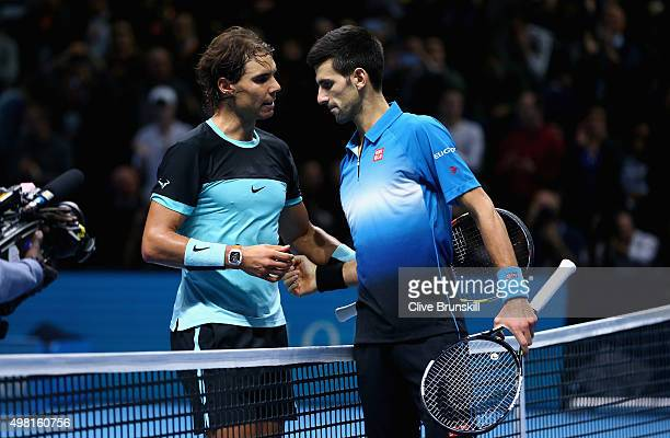 Novak Djokovic of Serbia shakes hands at the net after his straight sets victory against Rafael Nadal of Spain during the men's singles semi final...