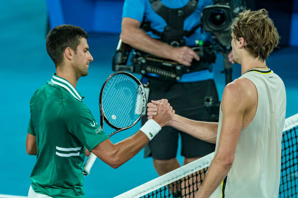 Novak Djokovic of Serbia shakes hands with Alexander Zverev of Germany after winning the Men's Singles Quarterfinals match against during day nine of...