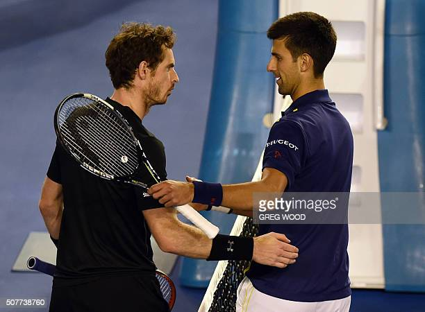 Novak Djokovic of Serbia shakes hands with Andy Murray of Britain following his victory in their men's singles final match on day 14 of the 2016...