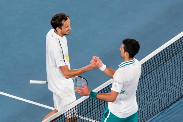 Novak Djokovic of Serbia shakes hands with Daniil Medvedev of Russia following his victory in the Men's Singles Final match against Daniil Medvedev...