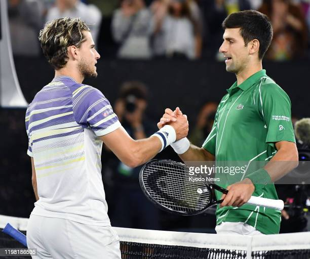 Novak Djokovic of Serbia shakes hands with Dominic Thiem of Austria after beating him in the Australian Open tennis final on Feb 2 in Melbourne