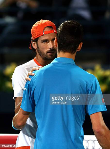 Novak Djokovic of Serbia shakes hands with Feliciano Lopez of Spain as he withdraws from his quarter final match on day six of the ATP Dubai Duty...