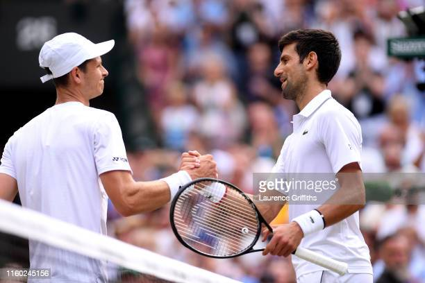 Novak Djokovic of Serbia shakes hands with Hubert Hurkacz of Poland after their mens singles third round match during Day five of The Championships...