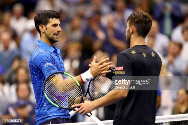 Novak Djokovic of Serbia shakes hands with Juan Ignacio Londero of Argentina after their Men's Singles second round match on day three of the 2019 US...