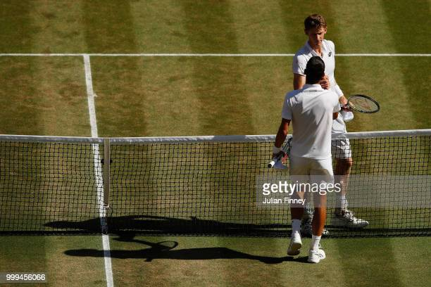 Novak Djokovic of Serbia shakes hands with Kevin Anderson of South Africa after the Men's Singles final on day thirteen of the Wimbledon Lawn Tennis...