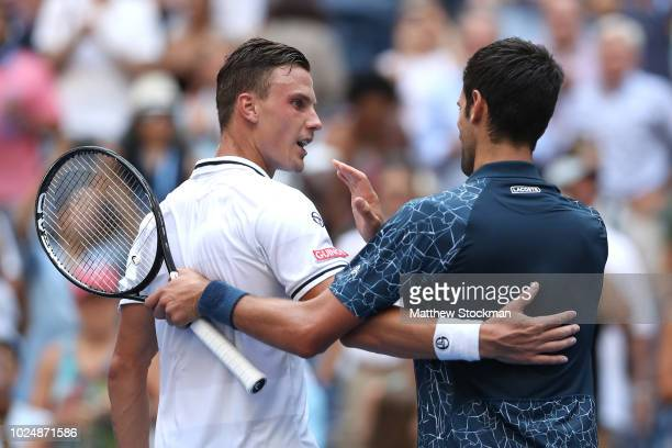 Novak Djokovic of Serbia shakes hands with Marton Fucsovics of Hungary after his win in the men's singles first round match on Day Two of the 2018 US...