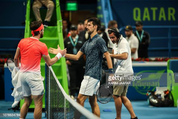 Novak Djokovic of Serbia shakes hands with Nikoloz Basilashvili of Georgia after defeating him in their ATP Qatar Open tennis quarterfinal match in...