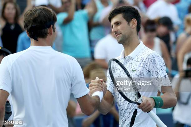 Novak Djokovic of Serbia shakes hands with Roger Federer of Switzerland after winning the mens final during Day 9 of the Western and Southern Open at...