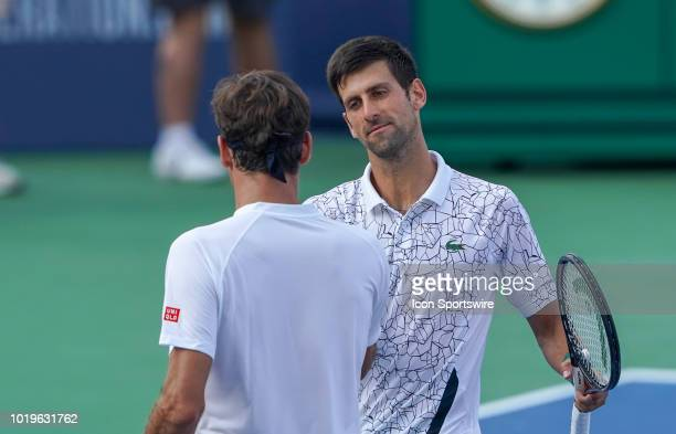 Novak Djokovic of Serbia shakes hands with Roger Federer of Switzerland after winning the Western Southern Open singles final at the Lindner Family...