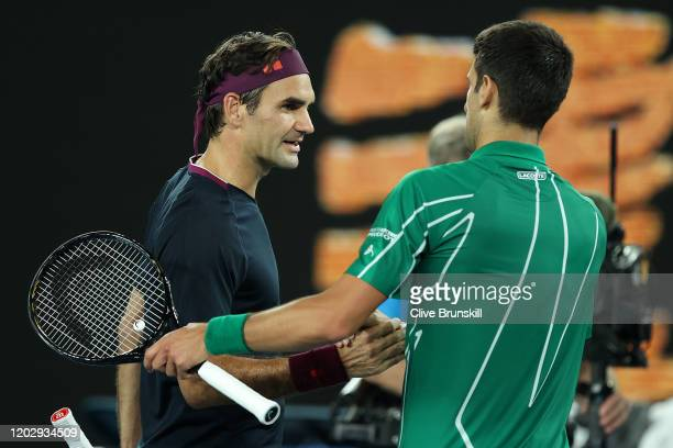 Novak Djokovic of Serbia shakes hands with Roger Federer of Switzerland after their Men's Singles Semifinal match on day eleven of the 2020...